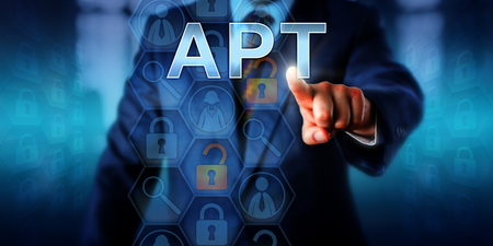 apt: Corporate cyber crime victim touching APT on a virtual screen. Information technology and computer security concept for Advanced Persistent Attack which is an ongoing hacking process or cyber threat. Stock Photo