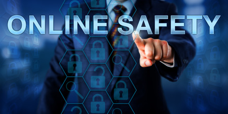technology metaphor: Network administrator is pressing ONLINE SAFETY on a touch screen interface. Information technology metaphor and security concept for personal safety of a corporate internet user accessing the web.