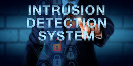 identifies: Manager is touching INTRUSION DETECTION SYSTEM on a virtual screen. Information technology and computer security concept for a traffic monitoring software device that identifies harmful data packets.