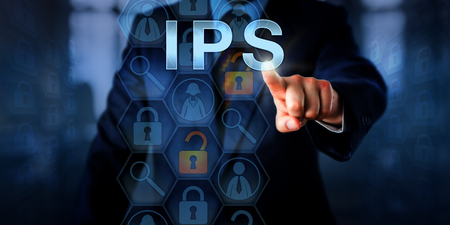intrusion: Corporate systems administrator is pushing IPS on a touch screen. Information technology and computer security concept for an intrusion prevention system that blocks malicious network connections.