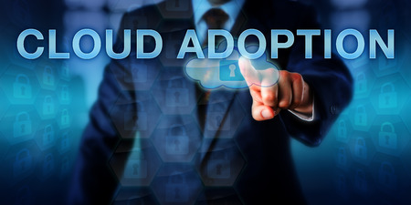 CIO is pressing CLOUD ADOPTION on a touch screen. Information technology concept and business strategy metaphor for transfer of traditional IT departments into serviced cloud computing solutions.