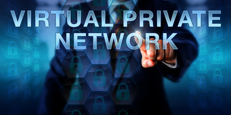 private information: Enterprise user is touching VIRTUAL PRIVATE NETWORK on a screen. Information technology concept and business model metaphor for a private computing network utilizing a public computer network.