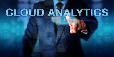 utilization: Information technology leader is touching CLOUD ANALYTICS on a virtual interface. Information technology concept and business strategy metaphor for efficient cloud computing resource utilization.
