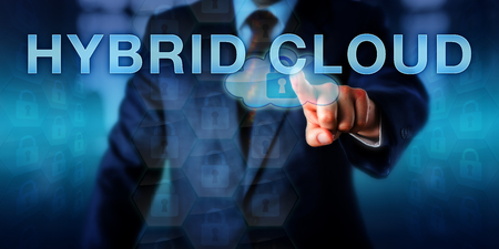 Corporate customer is pressing HYBRID CLOUD on a touch screen interface. Business metaphor and information technology concept for grounding enterprise IT partly in the cloud and partly on premise.