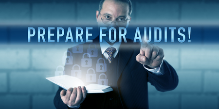 audits: Security director is pushing PREPARE FOR AUDITS! on a virtual screen interface. Business challenge metaphor and information technology concept for audit-readiness under regulatory requirements.
