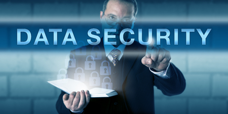auditor: Chief Information Security Officer or auditor is pushing DATA SECURITY on a visual screen. Business metaphor and information technology concept for the protection of data via encryption techniques.