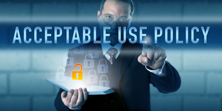 computer use: Business manager or corporate internet user is pressing ACCEPTABLE USE POLICY on a touch screen interface. Information technology concept for guiding principles regulating computer use. Stock Photo