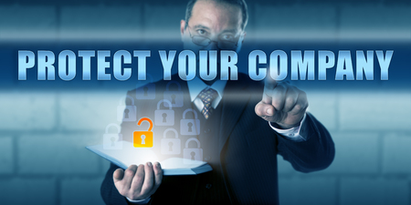 technology metaphor: Security advisor is touching PROTECT YOUR COMPANY on a virtual touch screen interface. Business challenge concept and information technology metaphor. Call to action for corporate security measures.