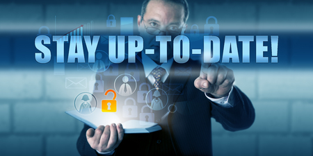 security gap: Corporate end user is pressing STAY UP-TO-DATE! on a virtual touch screen interface. Business challenge metaphor and information technology concept for keeping your IT knowledge and software current.