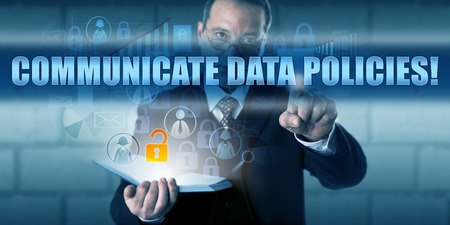 unstructured: Human resources director is pressing COMMUNICATE DATA POLICIES! on a virtual touch screen interface. Stock Photo