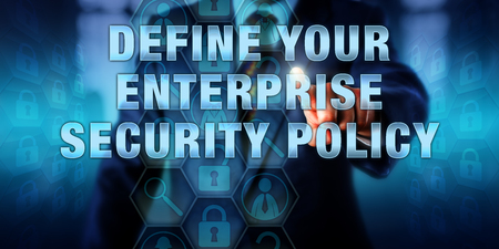 define: Manager is pushing DEFINE YOUR ENTERPRISE SECURITY POLICY on a visual interactive display. Stock Photo
