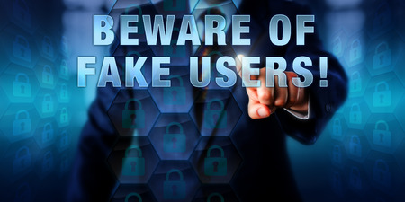 control fraud: Corporate manager pushing BEWARE OF FAKE USERS! on an interactive screen.