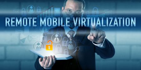 virtualization: Manager is touching REMOTE MOBILE VIRTUALIZATION on a visual interactive display. Stock Photo