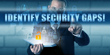 security gap: Manager touching IDENTIFY SECURITY GAPS! on a virtual touch screen interface. Stock Photo