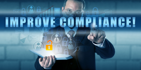 unstructured: Corporate director is touching IMPROVE COMPLIANCE! on an interactive virtual screen. Stock Photo