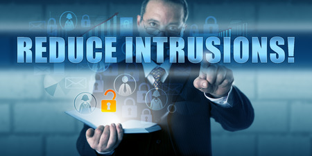 intrude: Cyber security expert is touching REDUCE INTRUSIONS! on a transparent interactive screen.