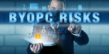 ownership and control: Human resources director is touching BYOPC RISKS on an interactive visual screen. Stock Photo