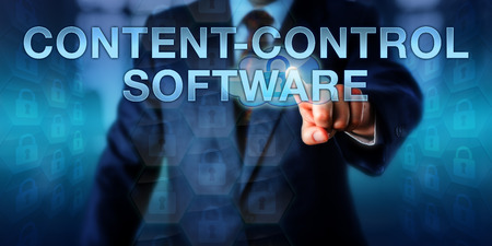 restricting: Manager is pressing CONTENT-CONTROL SOFTWARE on an interactive touch screen interface. Information technology and internet security concept for programs restricting readers to authorized content.