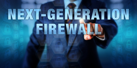 buzzword: Corporate manager is touching the technology buzzword NEXT-GENERATION FIREWALL on an interactive visual display.