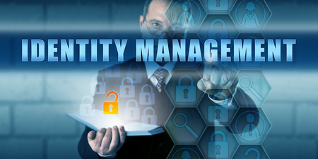 identity management: Manager pushing IDENTITY MANAGEMENT on a virtual interactive touch screen interface.