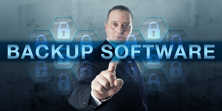 backup: Corporate manager is touching BACKUP SOFTWARE on a virtual transparent screen.