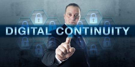 continuity: Manager pressing DIGITAL CONTINUITY on a touch screen display. Stock Photo