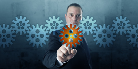 Male entrepreneur selecting a virtual cog wheel in a gear train line-up.