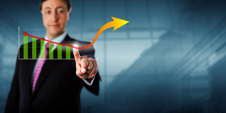 business trending: Business man is reversing a growth trend via touch. The trending line curves upward and culminates in an arrow head pointing at empty copy space. Business metaphor for boom and corporate growth. Stock Photo