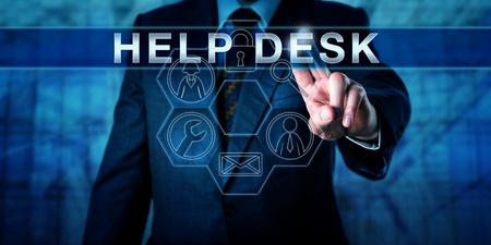 troubleshoot: Business person is pressing HELP DESK on a virtual interactive touch screen interface. Business metaphor and information technology concept. Service icons do light up in a hexagonal control matrix. Stock Photo