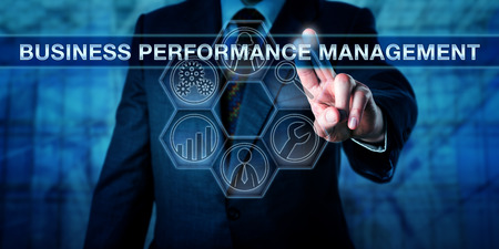 enable: Manager is pressing BUSINESS PERFORMANCE MANAGEMENT on an interactive touch screen interface. Technology concept and business performance management metaphor with tool icons for analytic processes. Stock Photo