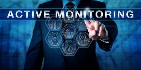 Managed service provider is touching ACTIVE MONITORING on a visual control display. Information technology metaphor and business concept for minimizing risk via remote monitoring and support. Banque d'images