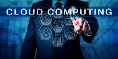 converged: Manager is pushing CLOUD COMPUTING on an interactive touch screen. Business process metaphor and information technology concept for converged infrastructure vie internet-based computing resources.