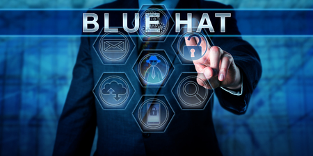 Blue chip software engineer pressing BLUE HAT on a virtual touch screen display. Business metaphor and computer security concept for an outside cybersecurity consultant troubleshooting for bugs.