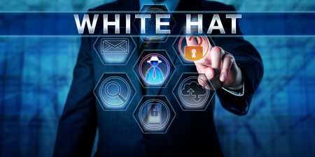 Manager pushing WHITE HAT on a touch screen interface. Cybersecurity metaphor. Information technology concept for an ethical hacker specializing in penetration testing of information infrastructure.