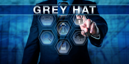 expose: Security software developer pushing GREY HAT on a virtual control screen. British English spelling. Computer security metaphor for a cracker hacking to expose and offer to fix a security flaw.