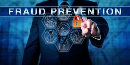 predictive: Male forensic expert is touching FRAUD PREVENTION on an interactive transparent control screen. Information technology concept for forensic or predictive analytics, internet fraud and cyber crime.
