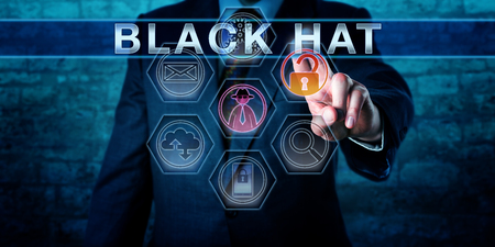 Forensic investigator touching BLACK HAT on a virtual control display. An unlocked padlock icon and a virtual hacker symbol do light up. Cybercrime concept for a criminal hacking for personal gain. Stock Photo