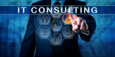 Corporate manager pushes IT consulting on an interactive touch screen interface. Business metaphor and information technology concept for consultative services relating to internet strategy planning.
