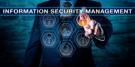 ism: Male corporate manager is touching INFORMATION SECURITY MANAGEMENT on an interactive control screen displaying virtual forensics tool icons. Cyber security concept and business metaphor for ISM. Stock Photo