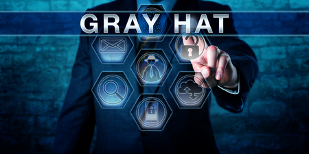 Cyber security investigator pressing GRAY HAT on a virtual interactive touch screen interface. American English spelling of the word GRAY. Security concept for an attacker exposing vulnerabilities.
