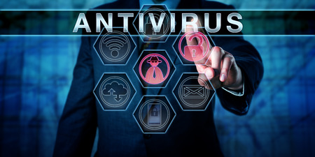 Corporate security manager is pushing ANTIVIRUS on a virtual interactive control screen interface. Business risk concept and computer security metaphor for anti-malware or anti-virus software. Stock Photo