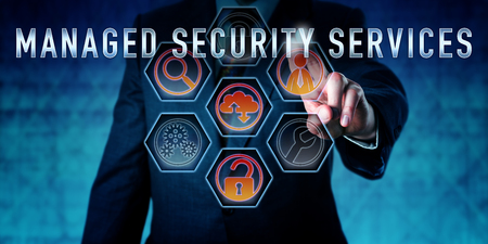 IT specialist is pressing MANAGED SECURITY SERVICES on an interactive virtual touch screen interface. Business metaphor and computer network security concept for outsourced MSS customer care. Stock Photo