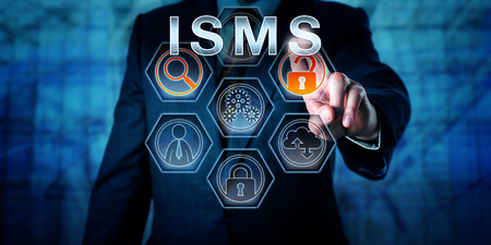 Male corporate security administrator is pushing ISMS on an interactive touch screen display. Business and IT risk metaphor and data security concept for information security management system. Stock Photo