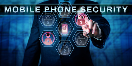 Male cyber criminal is pressing MOBILE PHONE SECURITY on an interactive touch screen interface. Black hat hacker and unlocked padlock icon do light up to signify an attempted mobile security breach. Stock Photo
