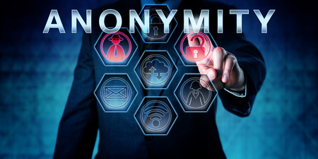 pseudonym: Internet services provider in blue suit is touching ANONYMITY on an interactive virtual control monitor. Business metaphor and information technology concept for anonymous internet access.