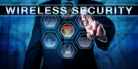 Male corporate manager is pushing WIRELESS SECURITY on an interactive touch screen interface. Business and computer security concept for vulnerabilities of wireless networks via rogue access points.