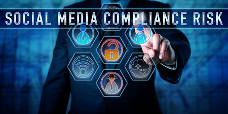 Manager is pushing SOCIAL MEDIA COMPLIANCE RISK on an interactive touch control screen. Business challenge metaphor and information technology concept for the pitfalls of corporate social networking. Stock fotó