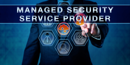 managed: Male business manager is pushing MANAGED SECURITY SERVICE PROVIDER on an interactive control screen. Business metaphor and internet security concept for outsourced network security management.