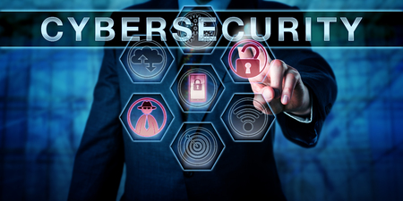 Security engineer is pushing CYBERSECURITY on an interactive virtual control screen. Computer security concept and information technology metaphor for risk management and safeguarding of cyber space. 写真素材