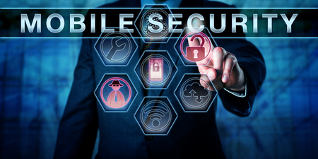 downloadable: Male software developer touching MOBILE SECURITY on an interactive visual control screen. Business risk metaphor and cyber security concept for privacy protection of cell phone networks and devices.